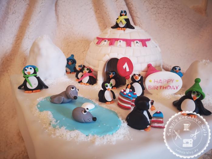 Iglu Motivtorte mit Pinguinen zum Geburtstag